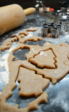 Process of baking gingerbread christmas cookies at home. Cutting tools