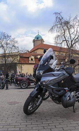 Honda XL125V Varadero motorbike, Podebrady castle on back