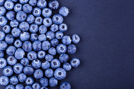 Top view photography blueberries stack on black background. Copyspace for your text design
