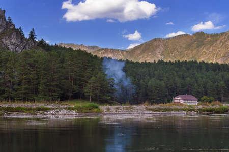 Smoke near house in Altai mountains