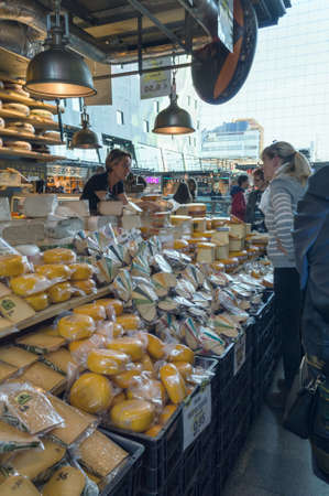 Rotterdam, The Netherlands, October 6, 2018: Cheese store at Market Hall with variety and prices