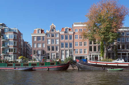 view on Amsterdam cityscape from river Amstel on sunny  october day