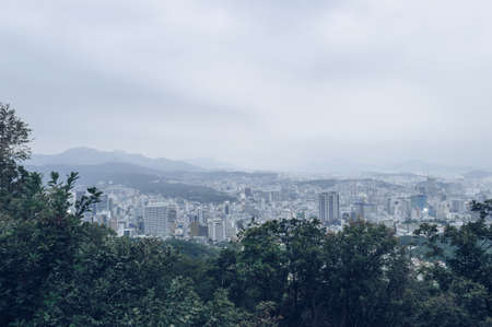 Seoul cityscape view from Namsan park at dusk time Stock Photo