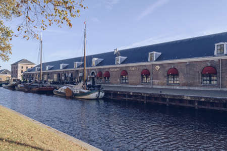 Den Helder, The Netherlands, October 13, 2018: exterior of Funtastic Casino with canal and boats in front of it