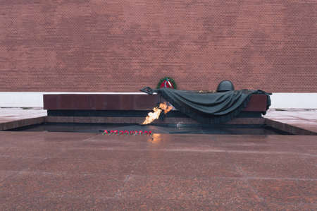 Moscow, Russia, March 07, 2017: Historical landmark Unkown soldier grave with eternal flame and red Kremlin wall