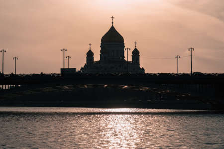 Silhouette of Cathedral of Christ the Saviour and bridge over Moskva river Stok Fotoğraf