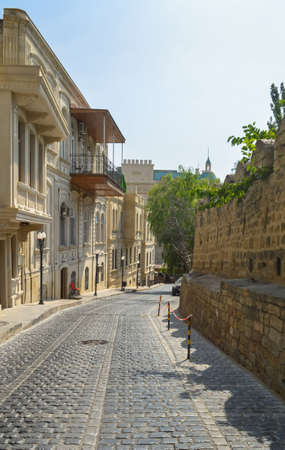 paved road just before walls of old town Baku