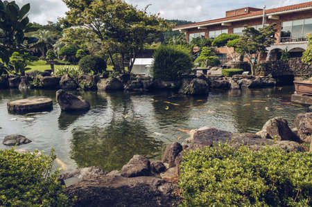 Jeju Island, South Korea, september 05, 2019: pond with koi carps inside of Spirited garden
