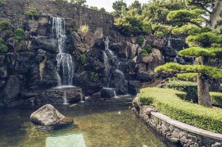 Jeju Island, South Korea, september 05, 2019: scenic view of waterfall inside of spirited garden 写真素材