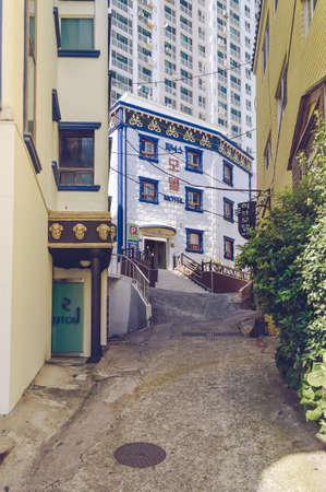 Busan, South Korea, September 14, 2019: narrow korean street with motels near Songdo beach