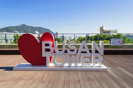 Busan, South Korea, September 14, 2019: Large sign of Busan tower with red heart and cityscape on background