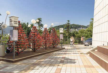 Busan, South Korea, September 14, 2019:  place for couples to set up their own heart shaped lock with names and wishes near Busan tower