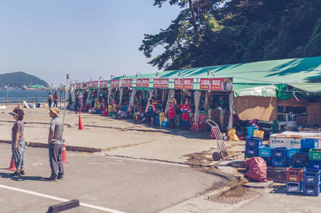 Busan, South Korea, September 14, 2019: small seafood market in the parking lot of Amnam park with sea view