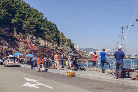 Busan, South Korea, September 14, 2019: view of korean people fishing at parking lot in Amnam park 報道画像