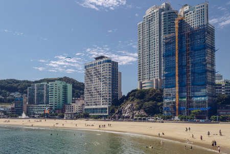 Busan, South Korea, September 14, 2019: people relaxing at Songdo beach on sunny day