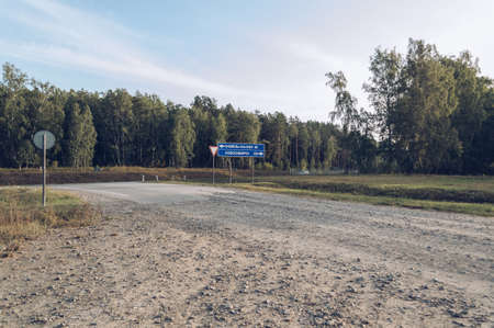 crossover of intercity and country roads in Russia adn road sign with directory to Novosibirsk and Kamen-on-Ob