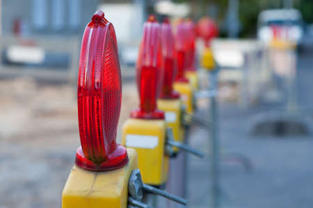 warning lights: Cordon with warning lights at a construction site. Stock Photo