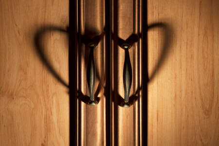 closet door: Heartshaped shadows from closet door pull handles