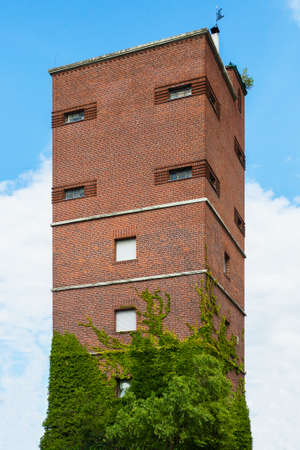 rigid: Tall brick tower against sky. Stock Photo
