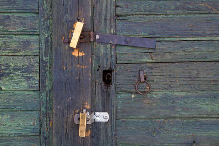 Locks on an old shed door.