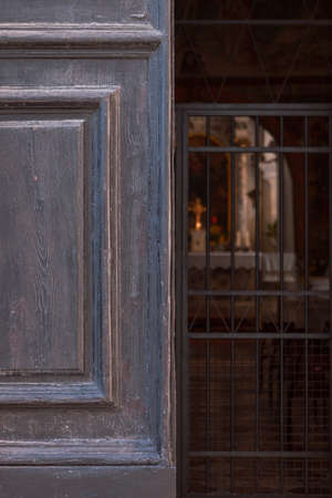 ajar: Half open church entrance with altar in the background Stock Photo