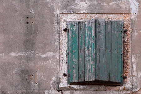 shutter: Green weathered window shutter