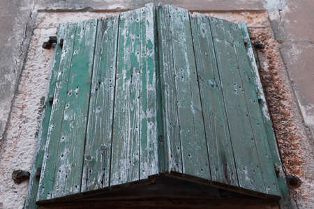 shutter: Weathered green window shutter Stock Photo