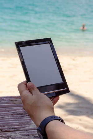 Reading on the beach with e-book reader