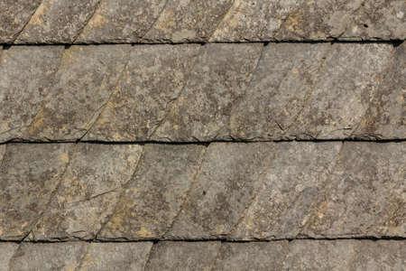 Weathered wall of slate tiles