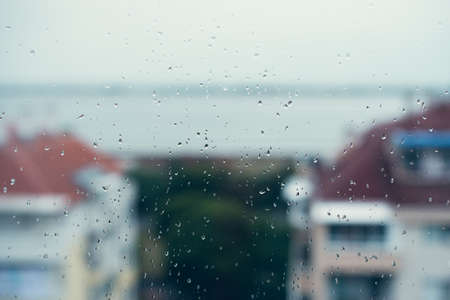 autumn colour: Sea view from window in rainy day.