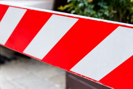 Red and white non-entry barrier. Restricted area.