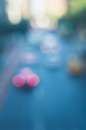 Urban concept - blurred unfocused cityscape background of New York city street. Out of focus city landscape with urban road, cars.