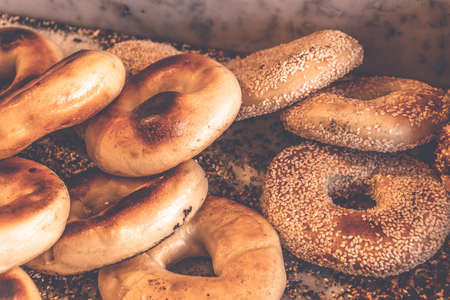 Authentic New York style freshly baked bagels sprinkled with black sesame and poppy seeds