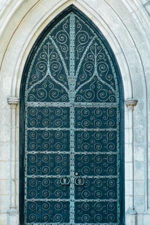 Metal green aged textured door with rings door handles and metal ornaments. Metal architecture background. Old green door in Manhattan, New York. 写真素材