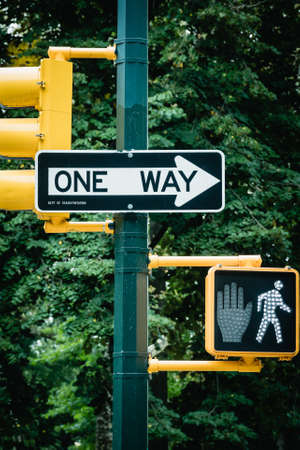New York City road sign One Way with traffic pedestrian light on the street in Manhattan. Urban city lifestyle photo
