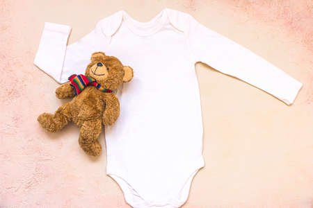 Newborn White Blank Unisex Baby Styled Bodysuit with teddy bear toy. Flat Lay Mockup. 写真素材