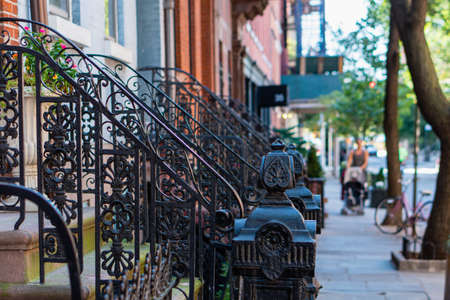 Classic red brick brownstone buildings with black iron railings in Greenwich Villages, Manhattan, New York Citty. Street scene 写真素材