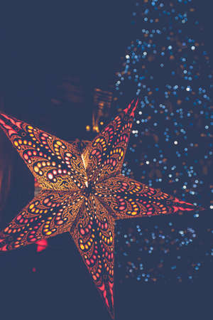 Colorful paper star-shaped lanterns at winter Christmas market in Vienna, Austria. Festive Background. 写真素材
