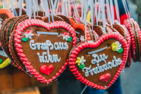 Traditional decorated Christmas gingerbread hearts on the Christmas market in Vienna.