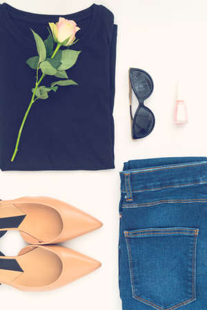 Flatlay of womens stylish neutral outfit on white background. Trendy clothes collage. Minimal and beauty blog concept.
