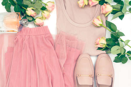 Female summer outfit and roses on white. Fashion, elegance and minimal concept. Flat lay romantic style look, top view 写真素材