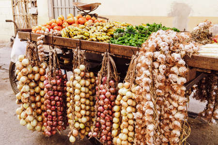 Street vendor cart of fruits and vegetables in a street in Cuba. Fresh food market. 写真素材
