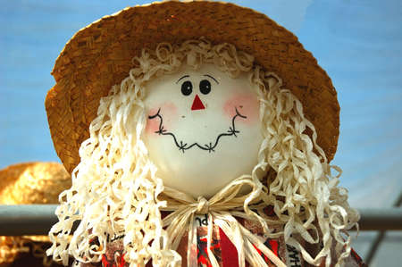 Scarecrow Face - The smiling face of a harvest scarecrow doll.