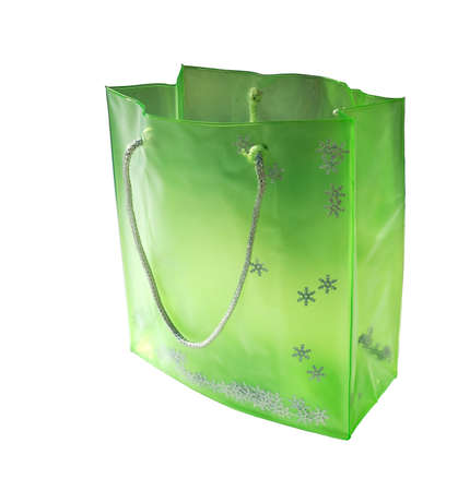 Green bag with silver snowflakes and handle.  Isolated over white.