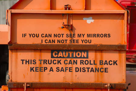 Caution Sign on the back of a work truck.