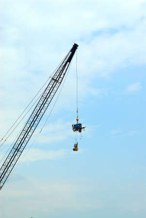 How's It Hangin'? - A crane lifts expensive construction equipment high in the sky to ward off theft.
