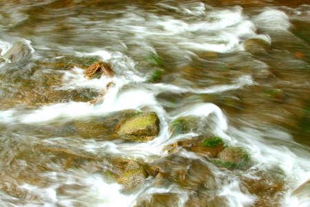 Haasten Waters tijd blootstelling. Stockfoto