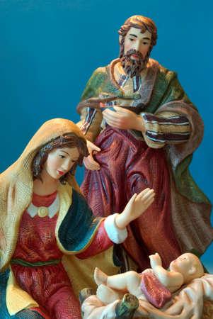 Holy Family - Joseph and Mary admire the  Jesus.r Imagens