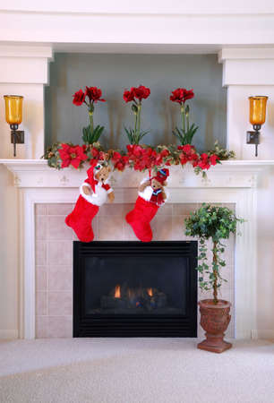 Christmas Stockings on the Mantle - Red and white fur christmas stockings hang on the mantle above the fireplace.  Imagens