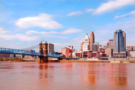 The Covington and Cincinnati Bridge, named after designer John A. Roebling, called by locals simply The Suspension Bridge, has been a symbol of the city since its completion in December of 1866.  More than just a nostalgic decoration, the old bridge rem Banco de Imagens